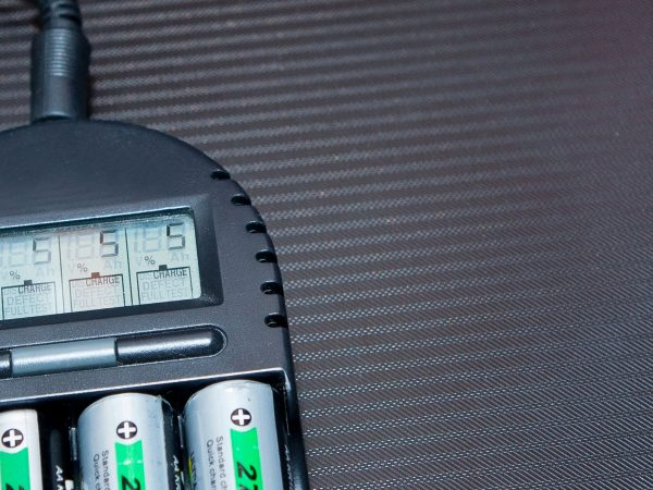 Close up of rechargeable lithium-ion battery with charger.